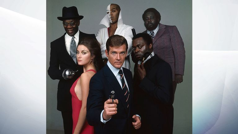 The cast of the James Bond film 'Live and Let Die', directed by Guy Hamilton, 1973. From front centre, clockwise, Roger Moore as Bond, Jane Seymour as Solitaire, Julius Harris as Tee Hee, Geoffrey Holder as Baron Samedi, Earl Jolly Brown as Whisper and Yaphet Kotto as Kananga