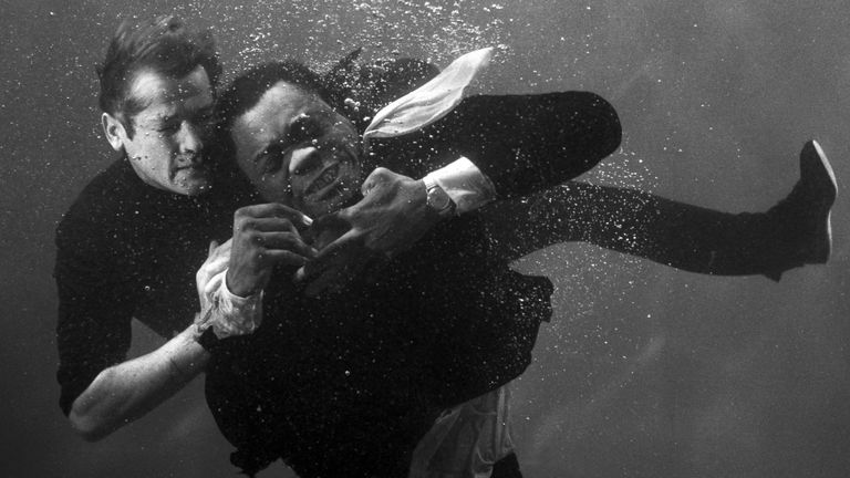 Roger Moore and Yaphet Kotto fighting under water on the film set 'Live and Let Die', 1973