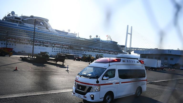An ambulance carries passengers away from the quarantined Diamond Princess cruise ship in Japan as 60 more were diagnosed with coronavirus