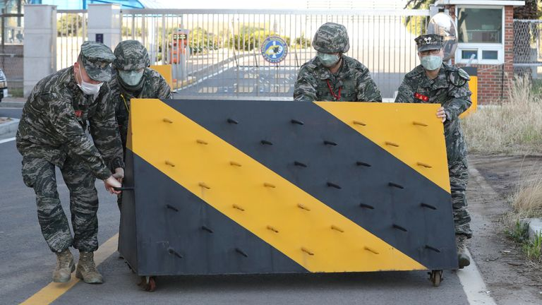 South Korean marines placed a barricade at the entrance of a navy base in Jeju Island after a marine contracted COVID-19