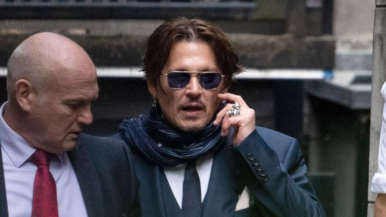 Johnny Depp (right) outside the High Court for a hearing in his libel case against the publishers of The Sun and its executive editor, Dan Wootton