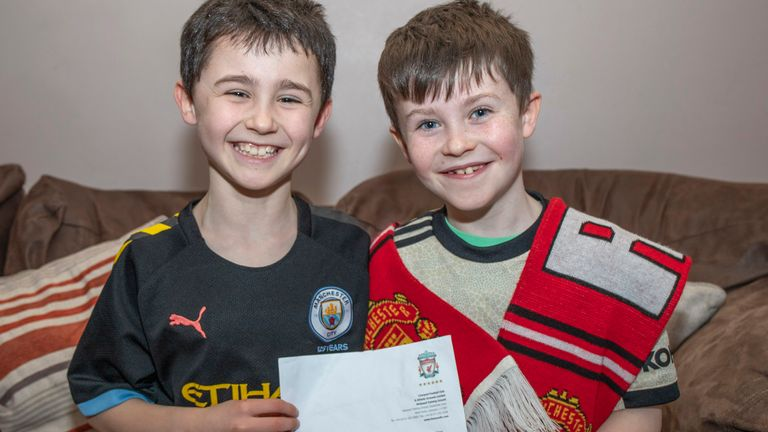 10 yr old Man Utd fan Daragh Curley (right) and his brother Dylan with his letter from Jurgen Klopp. Pic: North West Newspix