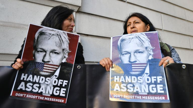 Supporters of Julian Assange hold signs outside Westminster Magistrates Court