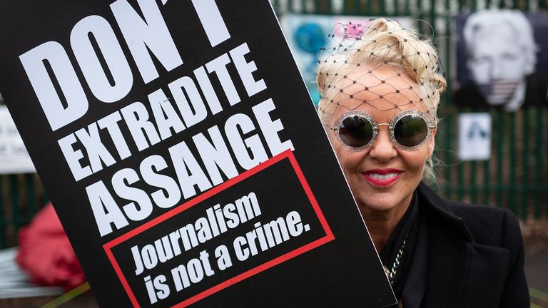 Supporters outside the court say Assange should not be extradited for disseminating the materials