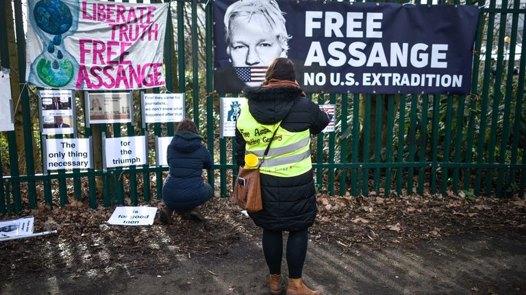 Supporters of WikiLeaks founder Julian Assange demonstrate outside Woolwich Crown Court