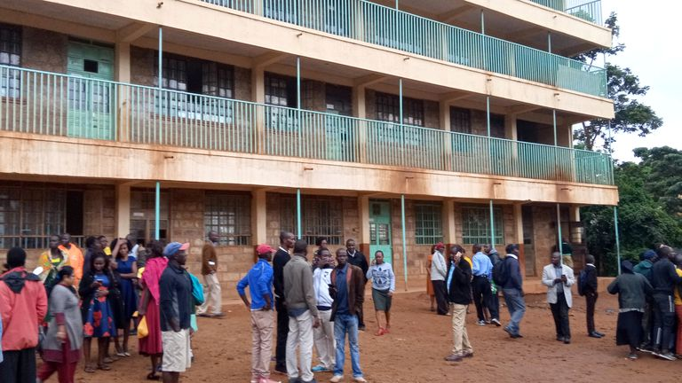 Parents and teachers gather near the scene of a stampede at Kakamega primary school