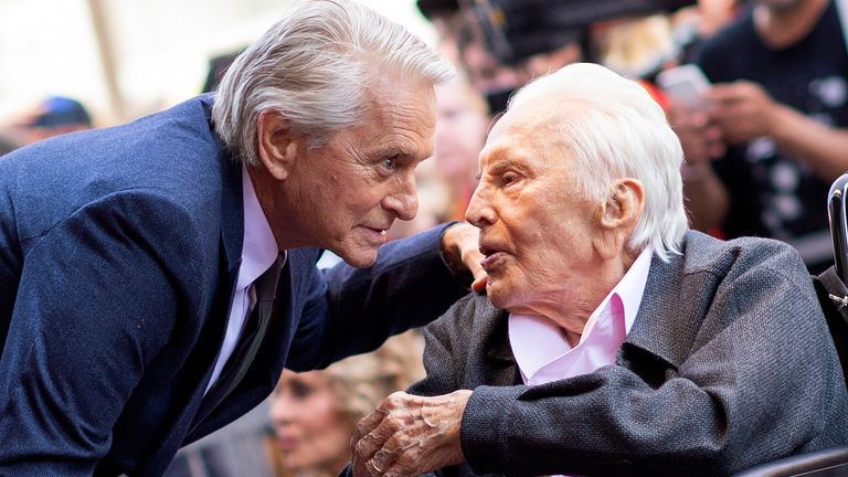 Actor Kirk Douglas (R) attends a ceremony honoring his son actor Michael Douglas (L) with a Star on Hollywood Walk of Fame, in Hollywood, California on November 6, 2018