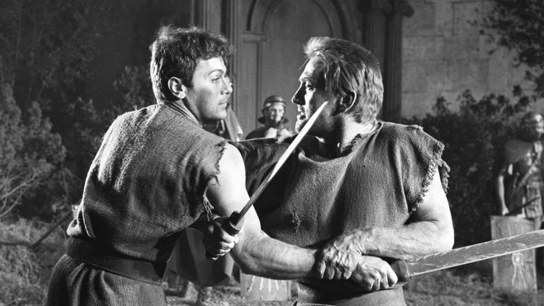 Kirk Douglas (r) in a sword fight scene from Spartacus with Tony Curtis