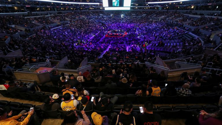 People attend a public memorial for NBA great Kobe Bryant, his daughter Gianna and seven others killed in a helicopter crash on January 26, at the Staples Center in Los Angeles, California, U.S., February 24, 2020. REUTERS/Lucy Nicholson