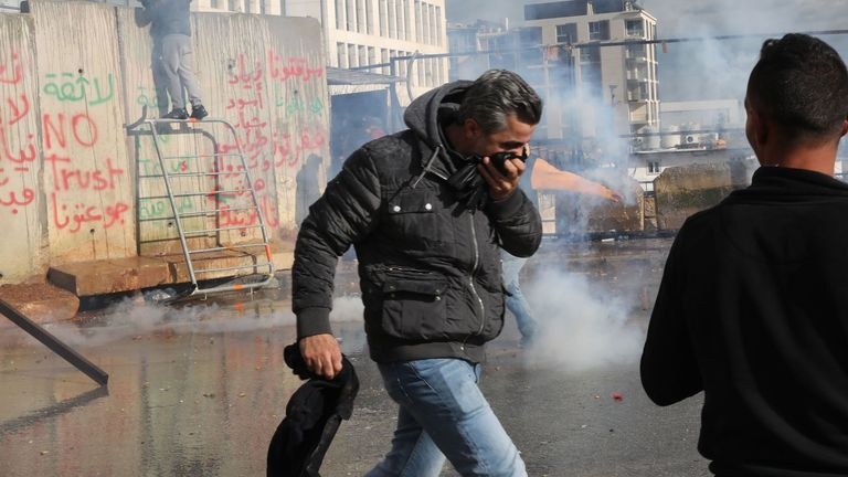 Security forces use tear gas to disperse protesters