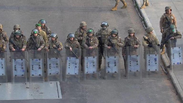 Security personnel prepare to combat protestors