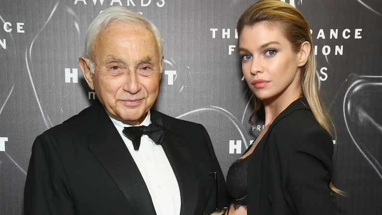 Les Wexner (L) and Stella Maxwell pose at the 2016 Fragrance Foundation Awards presented by Hearst Magazines - Show on June 7, 2016 in New York City