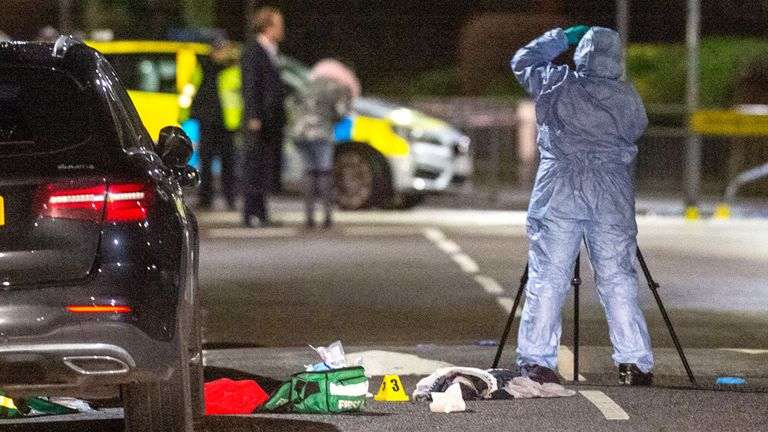 A forensic investigator gathers evidence next to medical equipment at the scene of a multiple stabbing in Barking. Pic: Peter Manning/LNP