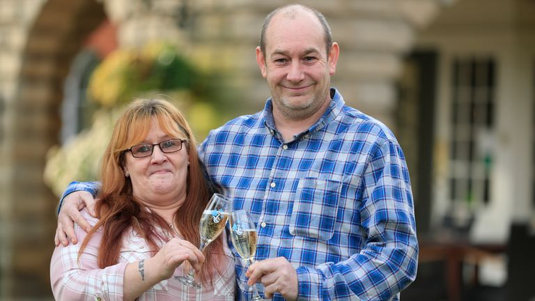 Malcolm and Bev Dixon, grandparents of 13 from Bolton, celebrating their one million pound lottery win at the Mercure Haydock Hotel in Haydock.