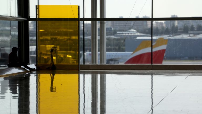 A tourist at Madrid's Barajas Airport