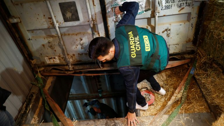 A Spanish civil guard enters the illegal underground tobacco factory during a police raid in Monda, near Malaga