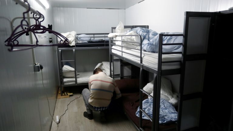 A cameraman films inside the facility which included bunkbeds for workers