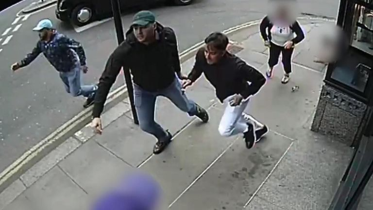 Detectives have released images of three men sought in connection with a vicious robbery where a valuable watch was stolen.