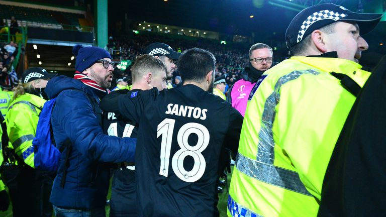 Pep Biel and Micheal Santos of FC Kobenhavn clash with officers from Police Scotland as Pep Biel celebrates his goal and a police officer is knocked over during the UEFA Europa League round of 32 second leg match between Celtic FC and FC Kobenhavn at Celtic Park on February 27, 2020 in Glasgow