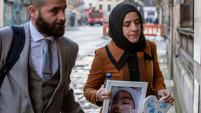 Midrar Ali's parents, Karwan Ali (left) and Shokhan Namiq