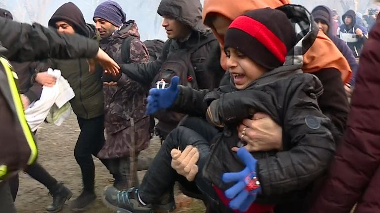 Migrants storm border crossing as Turkey says it will allow them into Europe.
