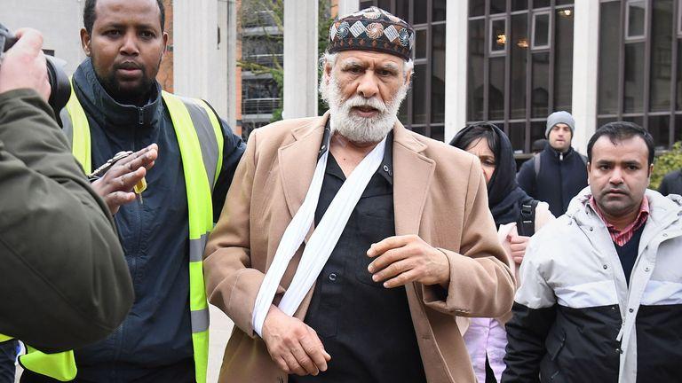 Muslim prayer leader Raafat Maglad arrives at the London Central Mosque, near Regent's Park
