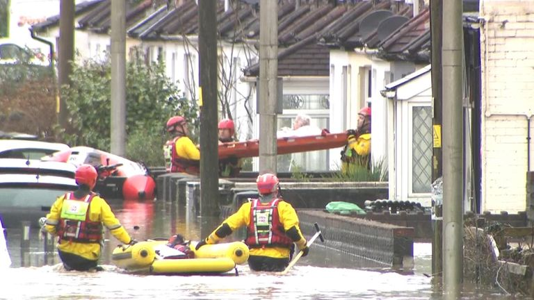 An elderly woman was rescued from her home in Nantgarw, Wales