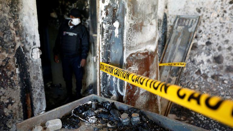 Police examine the scene in Port-au-Prince