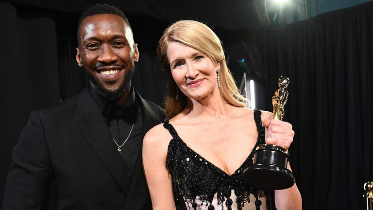Best supporting actress winner Laura Dern was presented with her prize by Mahershala Ali