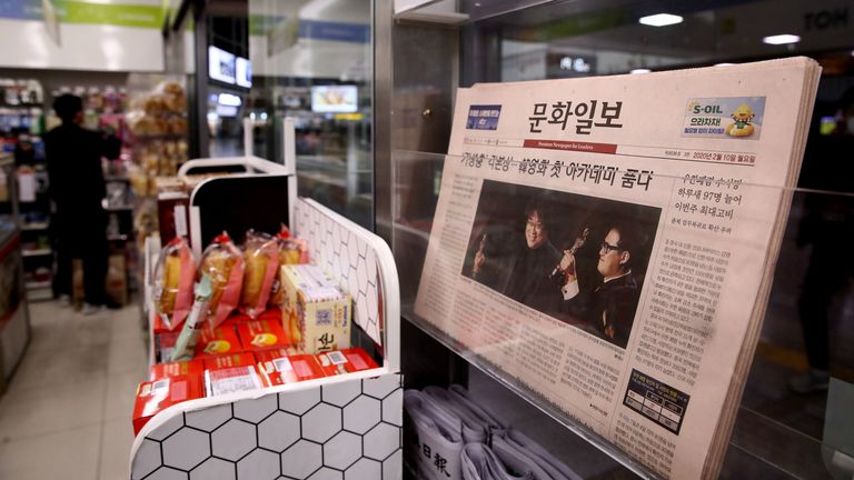 "Newspapers at a convenience store on February 10, 2020 in Seoul, South Korea. Bong Joon-ho's ""Parasite"" has bagged four Oscar titles, becoming the first non-English language film to win best picture"