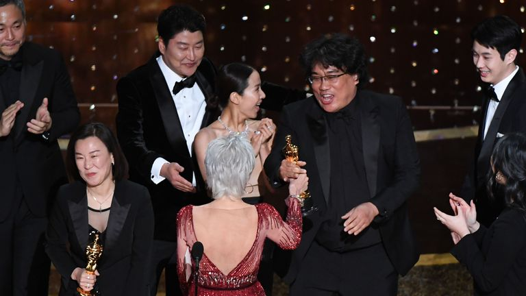 """Parasite"" producers Kwak Sin-ae (L) and Bong Joon-ho (R) accept the award for Best Picture for ""Parasite"" during the 92nd Oscars at the Dolby Theatre in Hollywood, California on February 9, 2020"