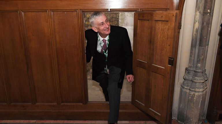 Commons Speaker Lindsay Hoyle inspects a secret doorway that has been found in parliament. Pic: UK Parliament/Jessica Taylor