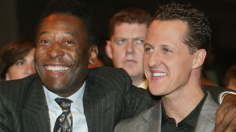 Pele with Formula one world legend Michael Schumacher at the 2003 World Cup preliminary draw