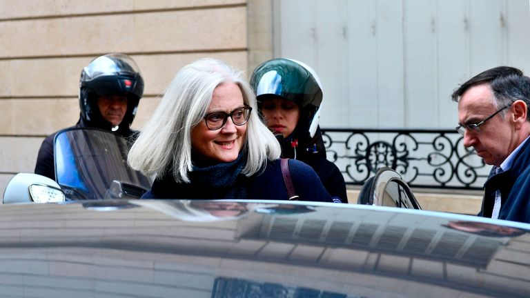 Former French prime minister Francois Fillon's wife Penelope leaves her home on February 24, 2020 in Paris. - Francois Fillon goes on trial over claims he embezzled more than a million euros in public funds by creating a fake job for his wife, a scandal that cost him his shot at the French presidency in 2017. Investigators suspect that Fillon, 65, hired his Welsh-born wife Penelope as his parliamentary assistant between 1998 and 2013, without having her do any actual work. (Photo by Martin BUREA