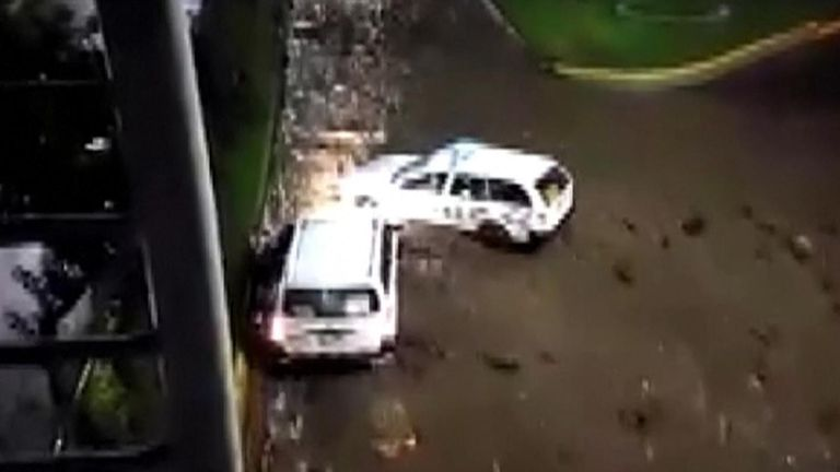 Cars wept away by flash flooding