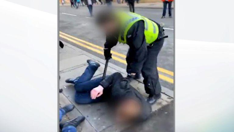 Police baton attack