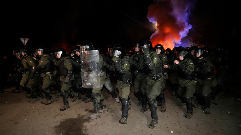Ukrainian police officers clashed with protesters in the village of Novi Sanzhary