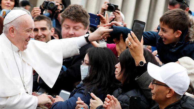 Pope Francis was seen touching masked members of a crowd on Wednesday.
