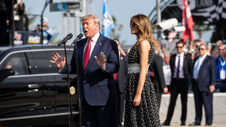 "President Donald Trump, accompanied by first lady Melania Trump, gives the instructions ""gentlemen, start your engines,"" before the start of the NASCAR Daytona 500"