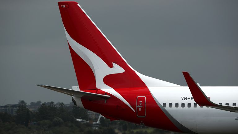 A Qantas commercial plane takes off at Sydney Airport on March 14, 2019 in Sydney, Australia