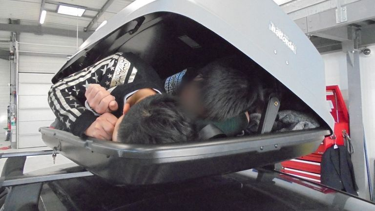 People smuggled in roof box