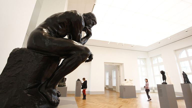 POTSDAM, GERMANY - JANUARY 19: The Statue of the French sculptor Auguste Rodin, The Thinker, stands as the visitors walk among the museum's exhibition spaces during a press preview in Barberini Museum on January 19, 2017 in Potsdam, Germany. The art museum will have a permanent collection from Plattner's foundation that focuses on 20th century German art, both from West and East Germany. The museum opens to the public on January 23 with an exhibition on Impressionist landscapes. (Photo by Michel