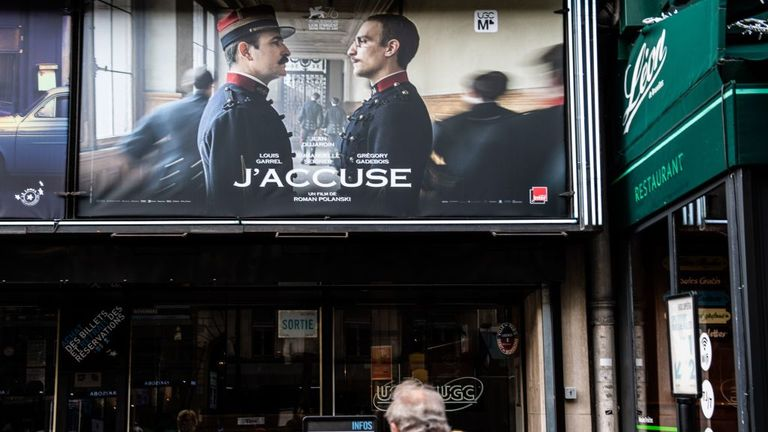 A poster for J'accuse displayed on a cinema in Paris