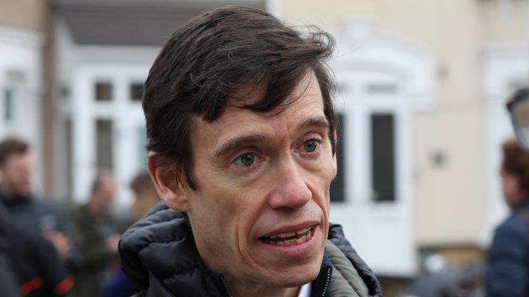 Former Tory MP Rory Stewart speaks to the media at the scene in Seven Kings, Ilford, east London, where three people died after being stabbed Sunday evening
