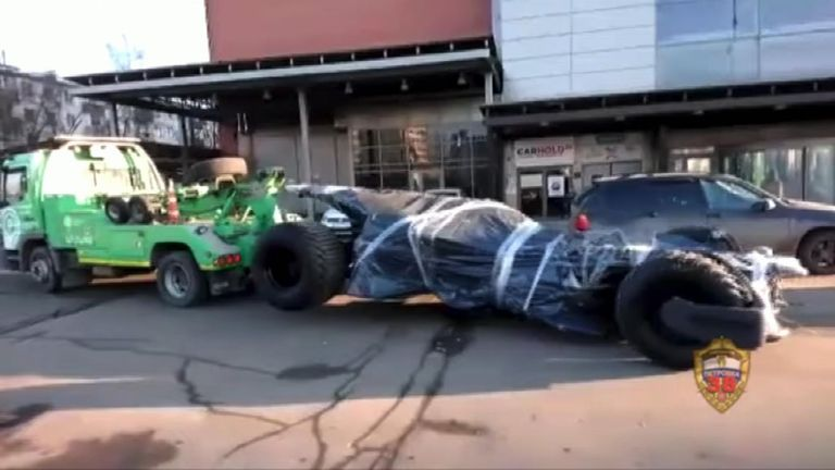 A homemade Batmobile was towed by traffic police in Moscow on February 22.  Footage released by the Ministry of Internal Affairs of Russia shows the modified vehicle, made to look like Batman's iconic car, being pulled away near Kutuzovsky Avenue.