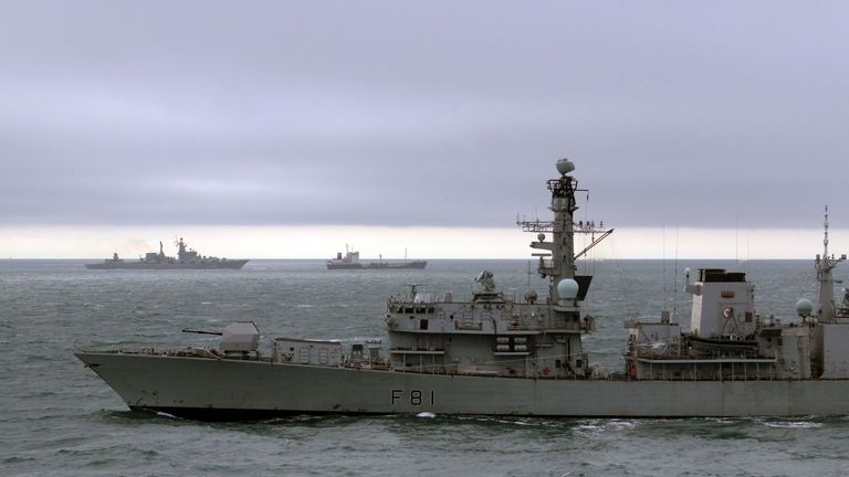 HMS Sutherland, front, leads the Russian missile cruiser Marshall Ustinov, top left, through the Channel