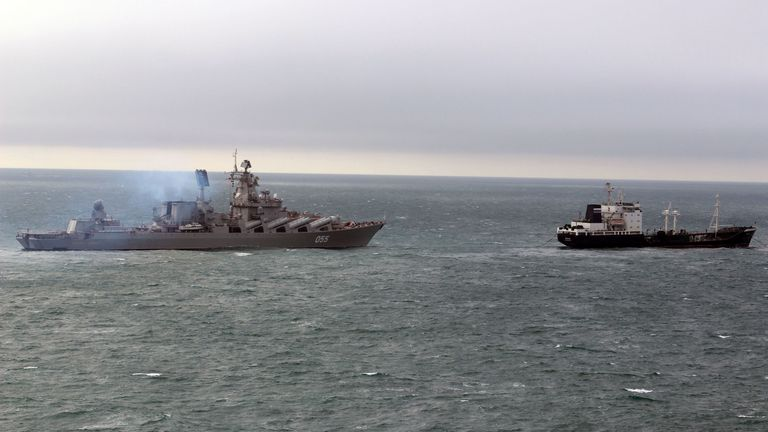 The Russian missile cruiser Marshall Ustinov , left, makes its way through the English Channel