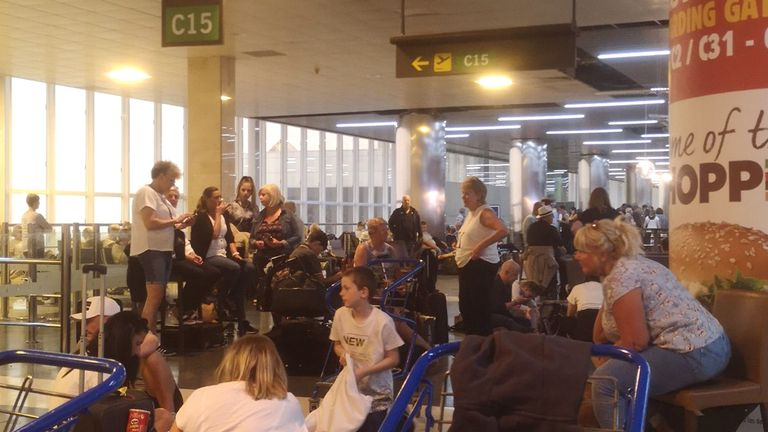 Handout photo issued by Simon Kimbrell of passengers sitting on the floor at Las Palmas airport