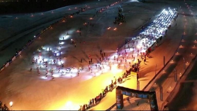 Italy's Giandomenico Salvadori and Poland's Justyna Kowalczyk won Italy's cross-country skiing event - the South Tyrol Moonlight Classic.