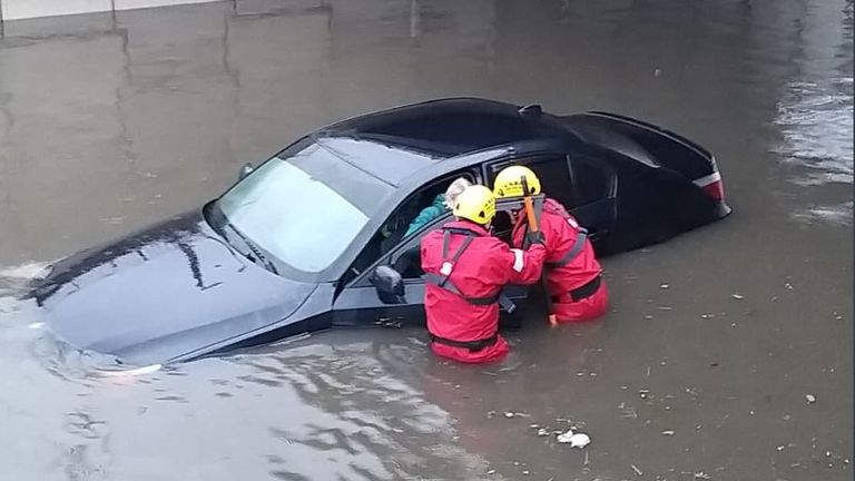 Firefighters in Blackpool rescued a driver whose car became stuck in deep floodwater